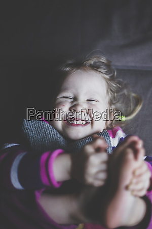 portrait of giggling toddler girl top