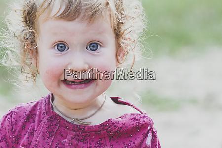 portrait of surprised toddler girl