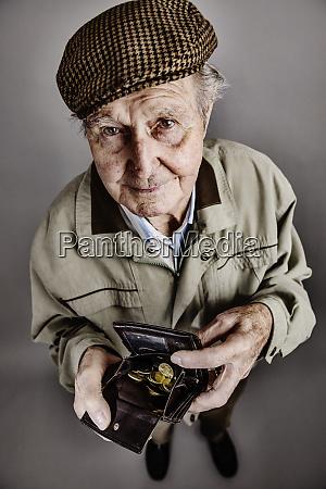 portrait of senior man showing his