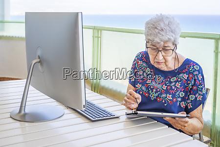 senior woman using computer on the