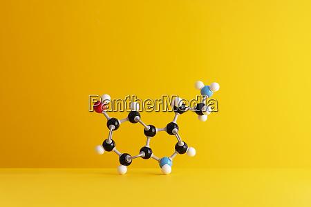 caffeine formulas molecular structure over yellow