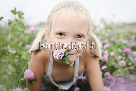 portrait of smiling girl with clover