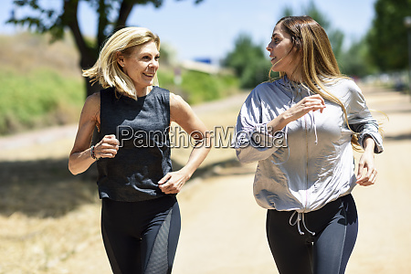 mature woman running with her daughter