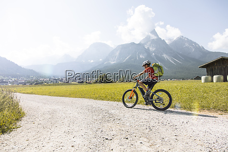 boy riding e mountain bike in
