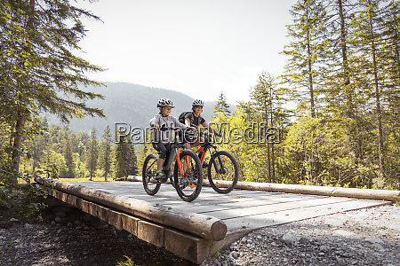 mother and daughter riding e mountain