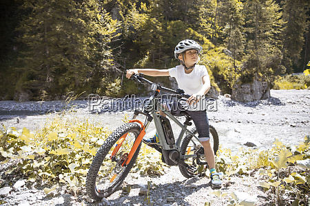 boy in the mountains with his