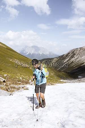 boy hiking in the mountains