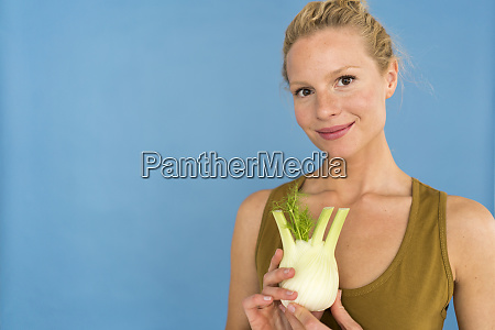 smiling blond woman with fennel blue