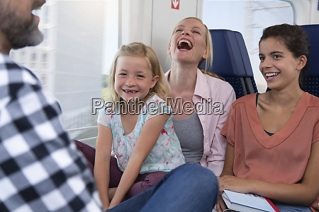 carefree family traveling in a train