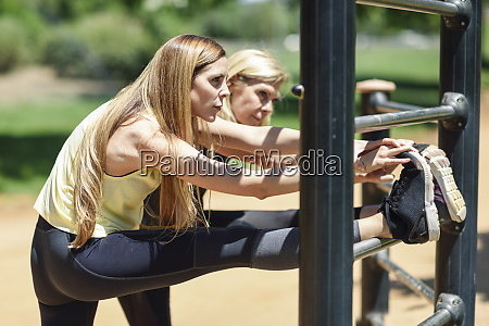 mature woman exercising with her daughter