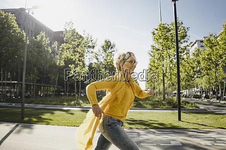mature woman running on the street