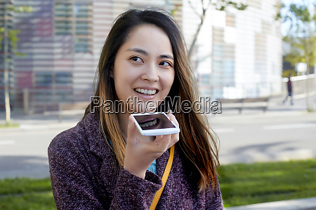 woman sending a voice message with