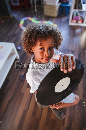 portrait of young dj with vinyl