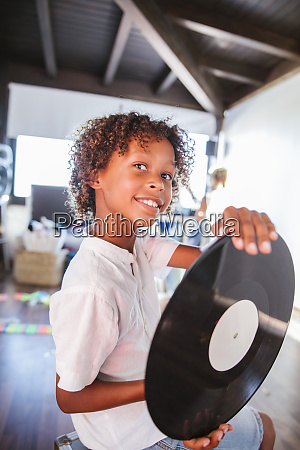 portrait of happy young dj with