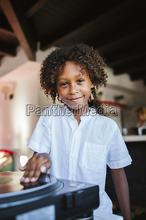 portrait of smiling young dj at