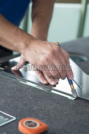 glazing glazier during work cutting glass