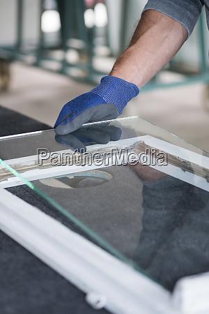 glazing glazier during work inserting glass