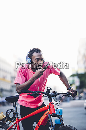 young man with e bike and