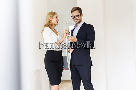 real estate agent handing over key
