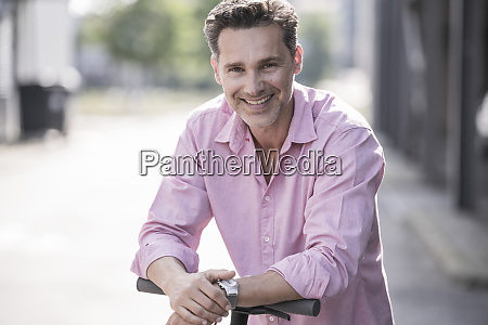 businessman with e scooter