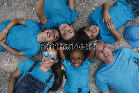 group of people happy lying on