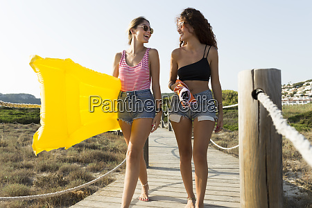 young women with yellow airbed and