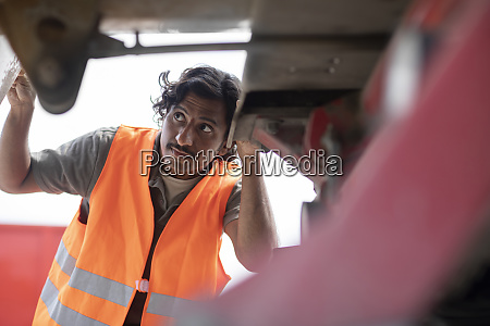 engineer checking lorry