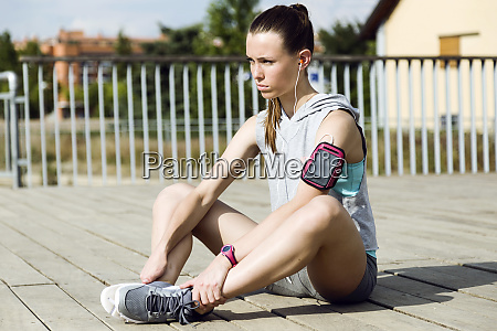 sporty teenage girl doing stretching exercise