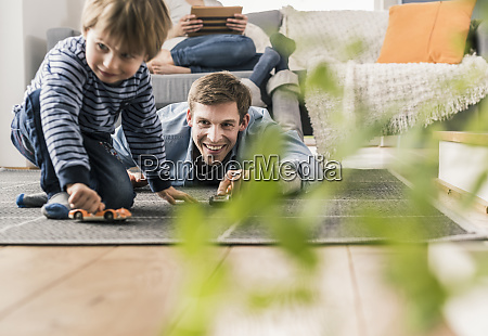 father and son playing with toy