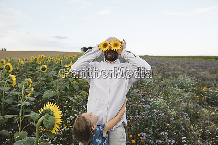 playful man covering his eyes with
