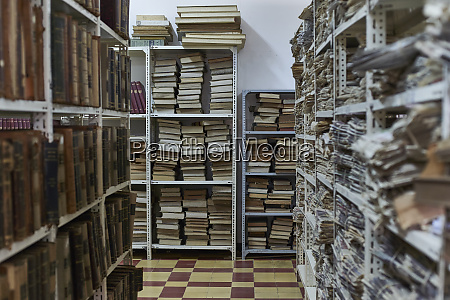 collection of books and newspapers at