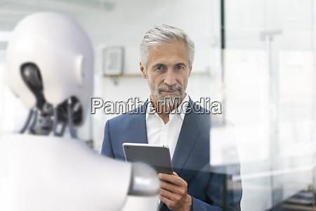 businessman using digital device to control