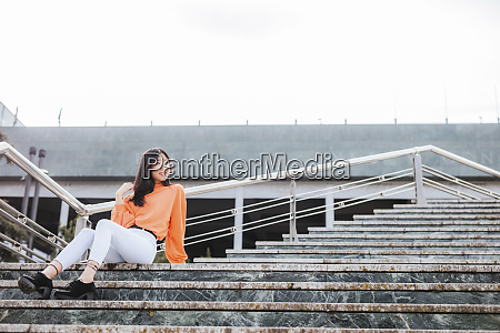 asian woman sitting on steps