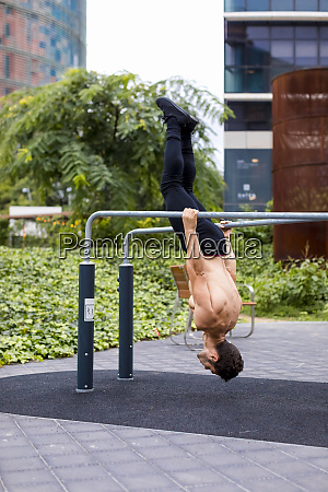 athlete training on bars in the