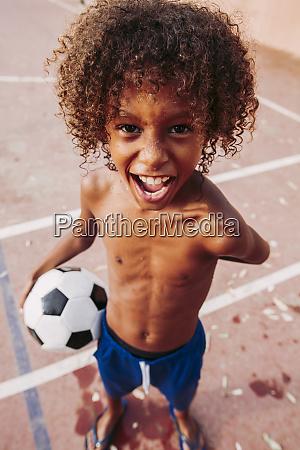 portrait of a boy holding a