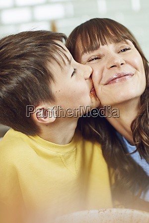 son kissing his mother portrait