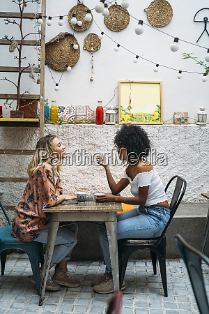 multicultural women in a cafe