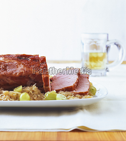 kasseler with sauerkraut and grapes in