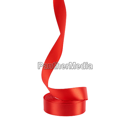 curled red satin ribbon isolated on
