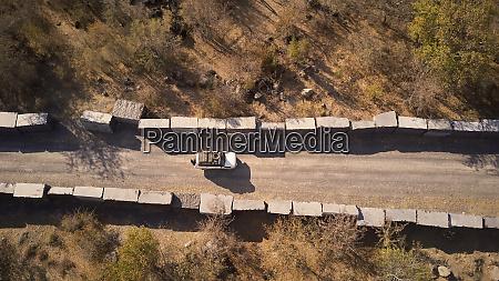 car circulating marble blocks in angola