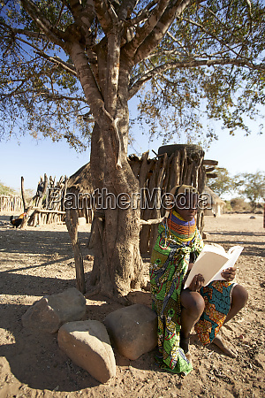 traditional muhila woman sitting under tree