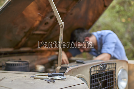 man with old car having a
