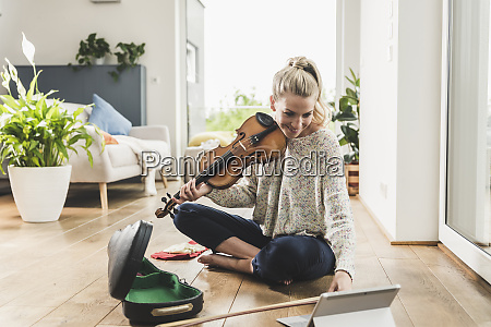 woman with tablet sitting on the