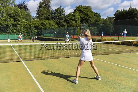 mature women during a tennis match