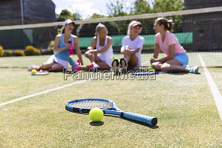 mature women at tennis club sitting