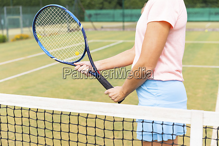 female tennis player holding the racket