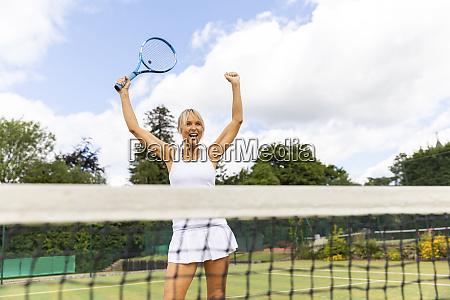 happy female tennis player celebrating the