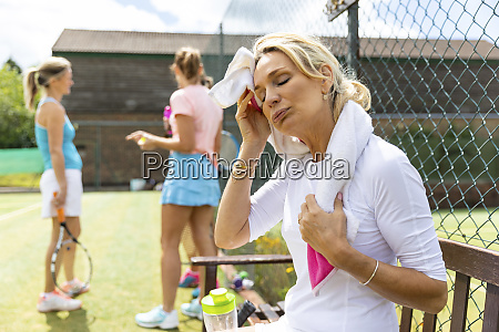 exhausted mature woman at tennis club