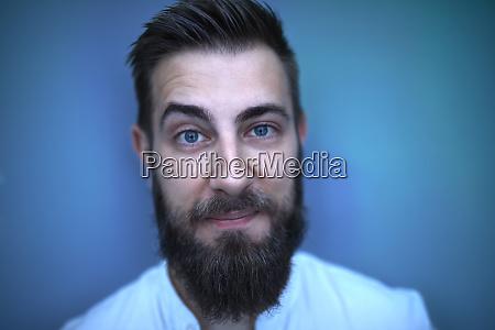 portrait of bearded man in blue