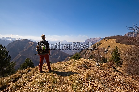 hiker with backpack standing on top